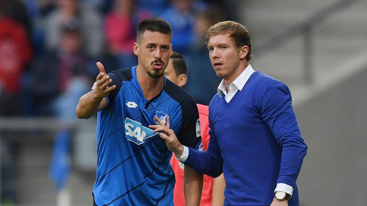 Sandro Wagner of Hoffenheim discusses with Head coach Julian Nagelsmann of Hoffenheim during the Bundesliga match between TSG 1899 Hoffenheim and SC Freiburg at Wirsol Rhein-Neckar-Arena on October 15, 2016 in Sinsheim, Germany.