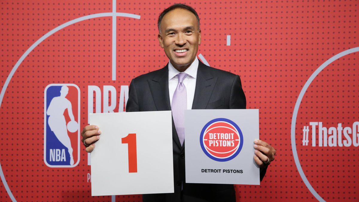 Deputy Commissioner of the NBA, Mark Tatum holds up the card of the Detroit Pistons after they get the 1st overall pick in the NBA Draft during the 2021 NBA Draft Lottery on June 22, 2021 at the NBA Entertainment Studios in Secaucus, N