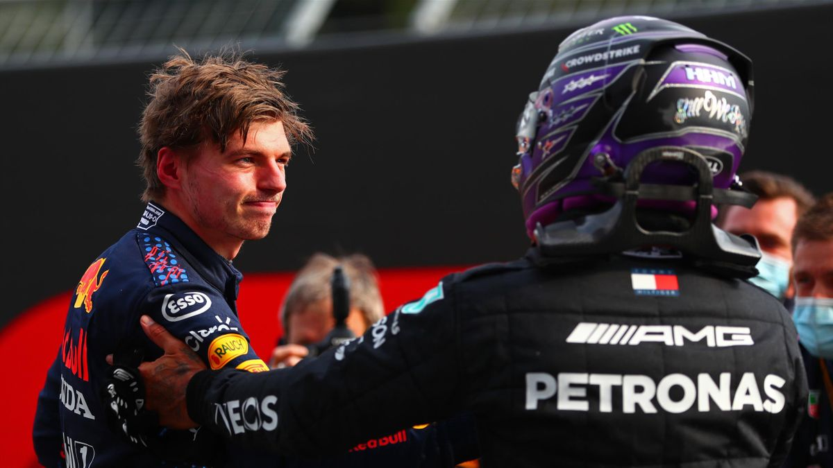 Lewis Hamilton of Great Britain and Mercedes AMG Petronas congratulates Max Verstappen of the Netherlands and Red Bull Racing in parc ferme after the F1 Grand Prix of Emilia Romagna at Autodromo Enzo e Dino Ferrari on April 18, 2021 in Imola, Italy