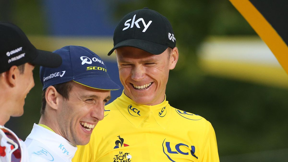 Chris Froome shares a joke with Simon Yates and Warren Barguil on the Tour de France podium