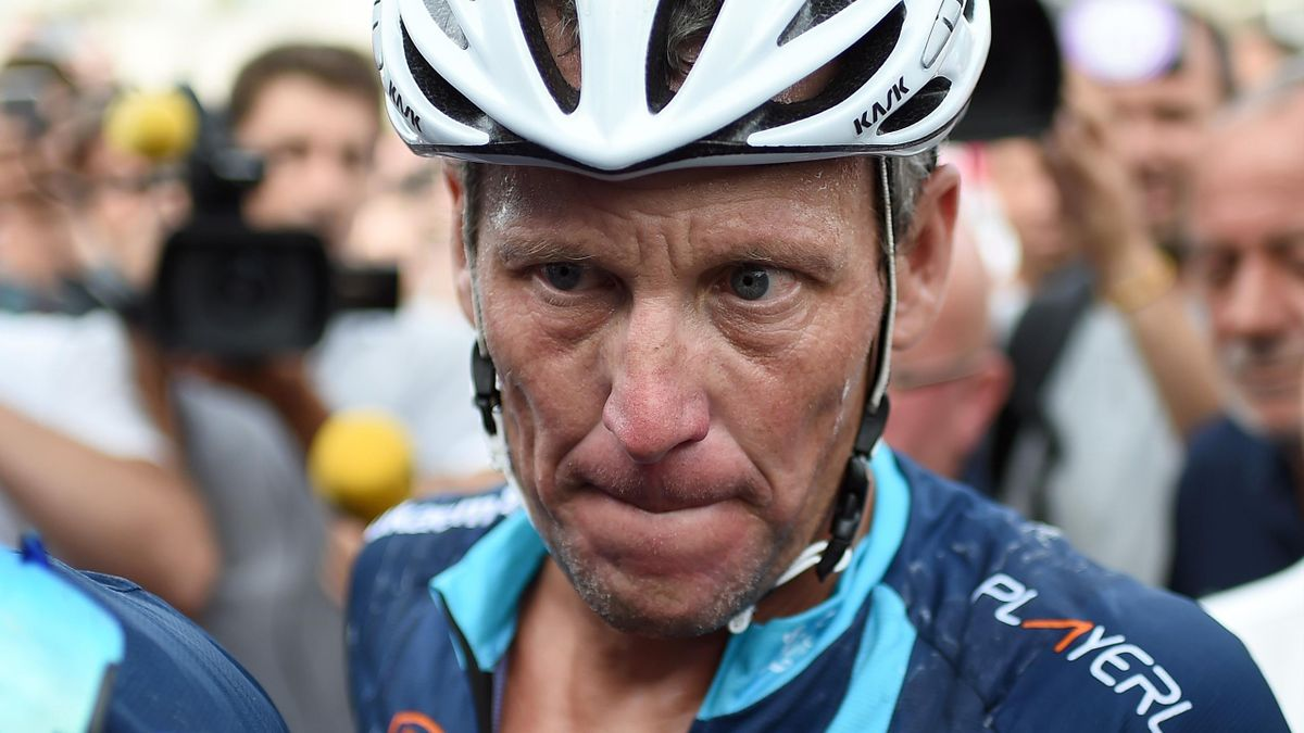 Lance Armstrong looks on upon his arrival in Rodez, southwest France, after riding a stage of The Tour De France for a leukaemia charity, a day ahead of the competing riders, on July 16, 2015