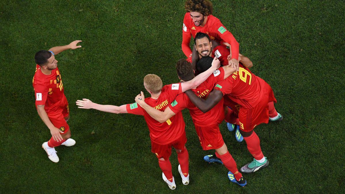 Nacer Chadli of Belgium celebrates after scoring his team's third goal with team mates