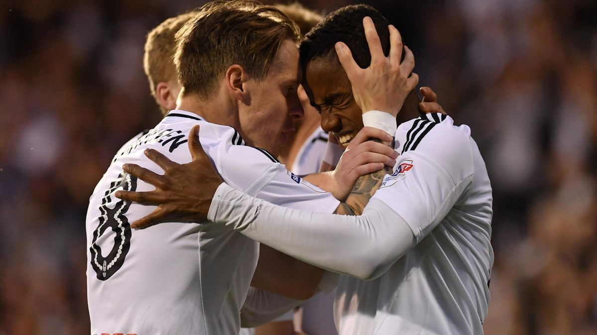 Ryan Sessegnon of Fulham celebrates with team mate Stefan Johansen after scoring his sides first goal during the Sky Bet Championship Play Off Semi Final