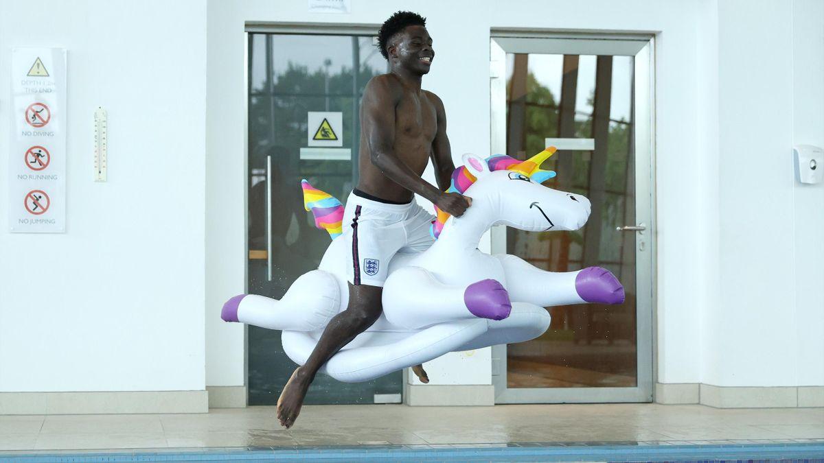 Bukayo Saka on an inflatable unicorn, St George's Park on July 04, 2021 in Burton upon Trent, England