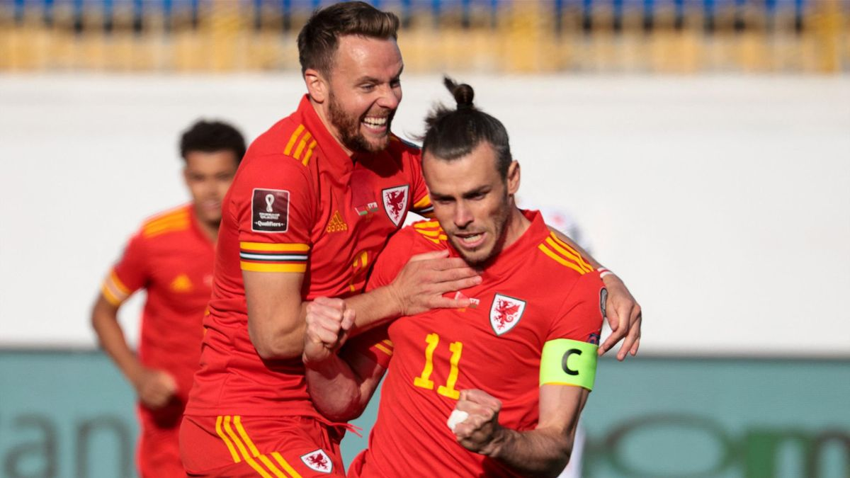 Wales' forward Gareth Bale (R) celebrates after scoring the opening goal from the penalty spot during the FIFA World Cup Qatar 2022 qualification football match between Belarus and Wales in Kazan on September 5