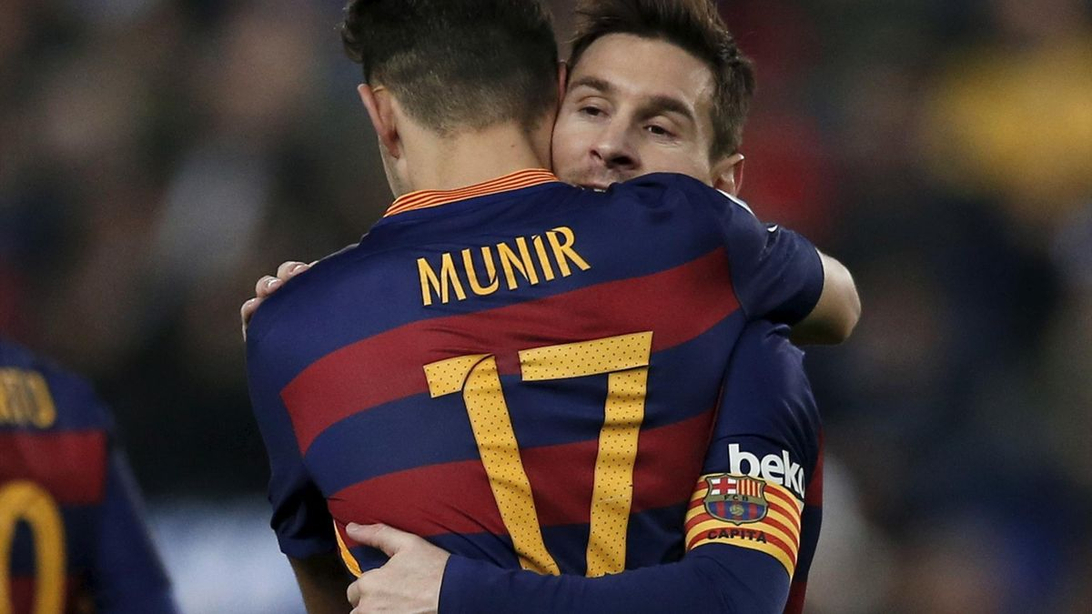 Barcelona's Munir el Haddadi and Lionel Messi (facing camers) celebrate a goal against Espanyol.