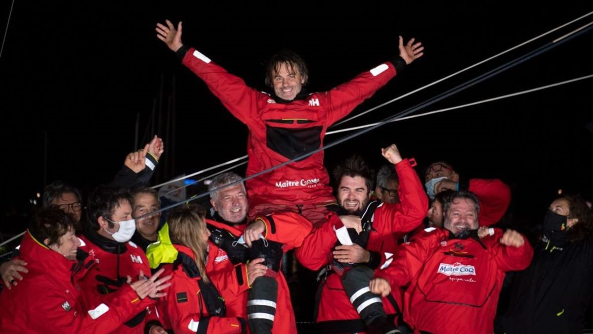 French skipper Yannick Bestaven, who sailed his Imoca 60 monohull 'Maitre CoQ' in the 2020/2021 ninth edition of the Vendee Globe round-the-world solo race holds his trophy after crossing the finish line at Les Sables d'Olonne, western France, on January