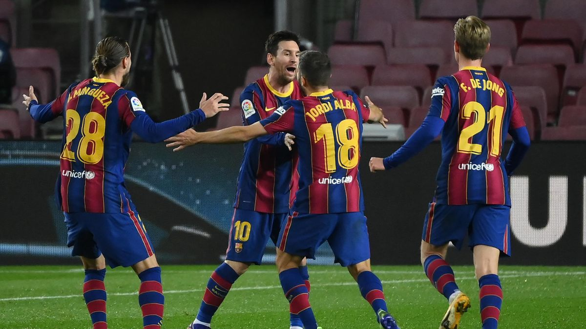 Barcelona's Spanish defender Jordi Alba celebrates his goal with Barcelona's Argentinian forward Lionel Messi during the Spanish league football match between FC Barcelona and Real Sociedad at the Camp Nou stadium in Barcelona on December 16, 2020.