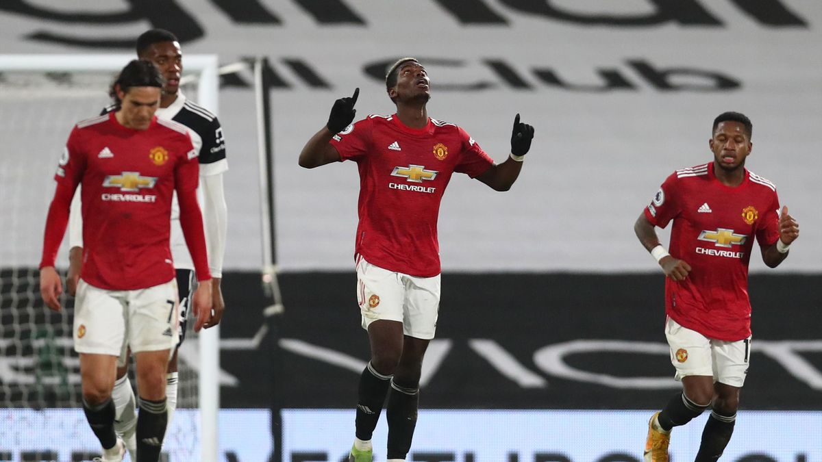 Paul Pogba of Manchester United celebrates after scoring their side's second goal during the Premier League match between Fulham and Manchester United at Craven Cottage on January 20, 2021 in London, England.