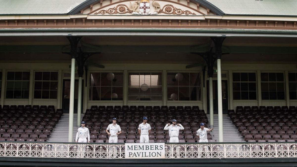 teve Smith, Pat Cummins, Mitch Starc, Nathan Lyon and David Warner of New South Wales Blues look on as they wait for the Sheffield Shield winning team photo at Sydney Cricket Ground on July 10, 2020 in Sydney, Australia. New South Wales won the 2020 Sheff