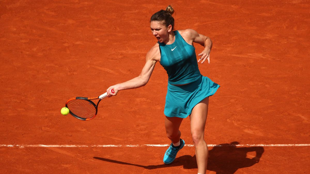Simona Halep of Romania plays a forehand during her ladies singles second round match against Taylor Townsend of The United States during day five of the 2018 French Open