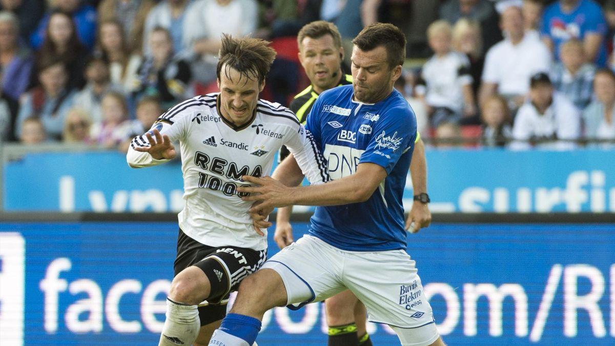Mike Jensen (tv) og Ranheims Vegard Voll under NM kampen på Lerkendal stadion. Kampen endte 3-4.