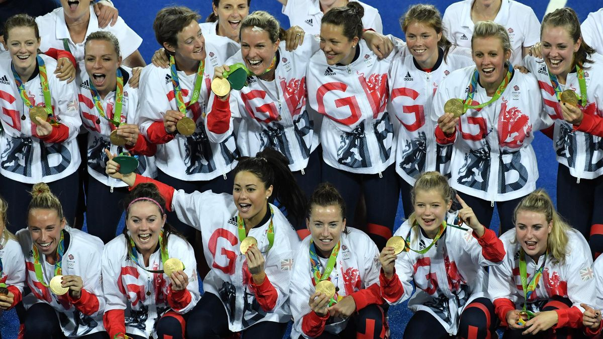 Britain's players pose with their gold medals during the women's field hockey