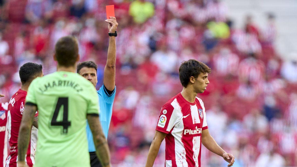 Referre Gil Manmzano (L) shows the red card to Joao Felix (R) of Atletico de Madrid