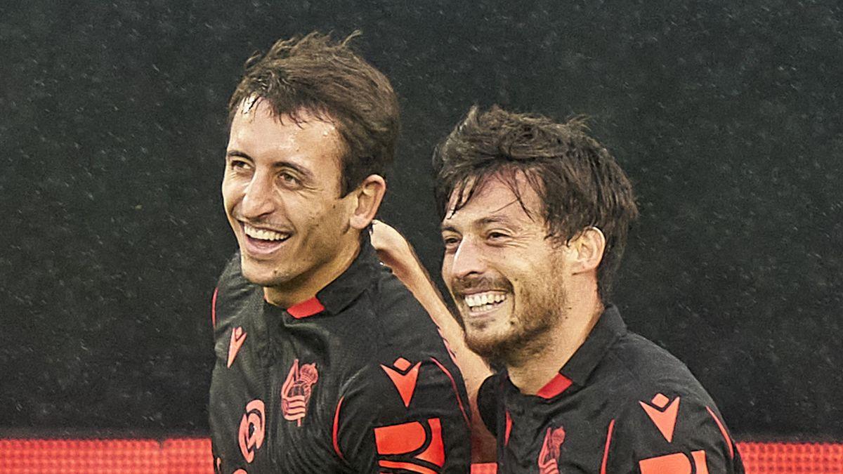 David Silva (R) of Real Sociedad celebrates with Mikel Oyarzabal