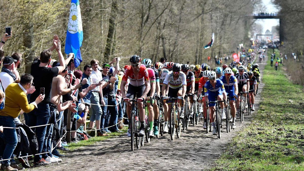 Cyclists compete during the 116th edition of the Paris-Roubaix one-day classic cycling race, between Compiegne and Roubaix