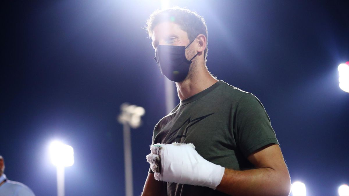 Romain Grosjean of France and Haas F1 walks in the Paddock with bandages on his burnt hands after his crash at the previous race during previews ahead of the F1 Grand Prix of Sakhir at Bahrain International Circuit on December 03, 2020 in Bahrain, Bahrain