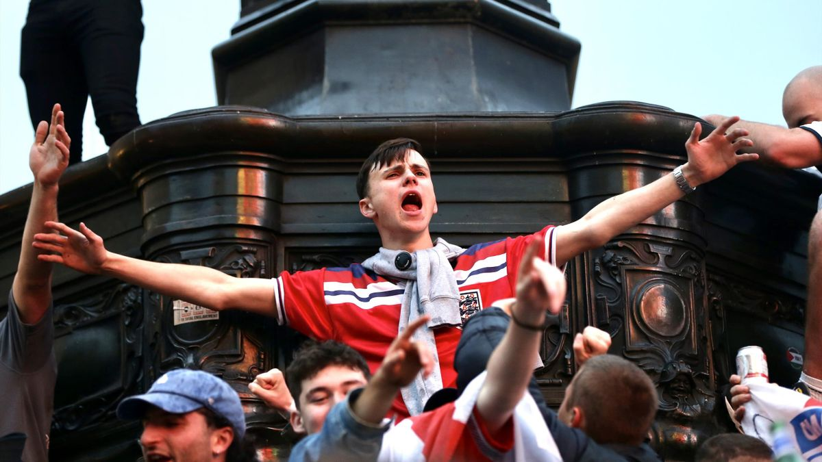 Fans of England celebrate after winning EURO 2020 Round of 16 match against Germany, at Piccadilly Circus in London, United Kingdom on June 29, 2021.