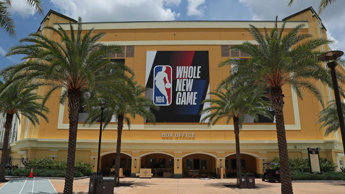 """An exterior shot of The Arena at ESPN Wide World of Sports with the """"Whole New Game"""" signage as part of the NBA Restart 2020 on July 16, 2020 in Orlando, Florida."""