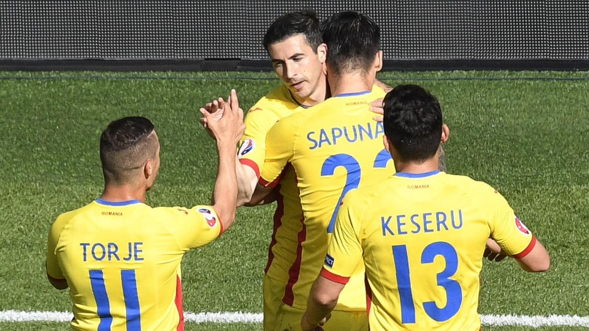 Romania's forward Bogdan Stancu (2nd L) celebrates with team mates after scoring a penalty during the Euro 2016 group A football match between Romania and Switzerland at the Parc des Princes stadium in Paris on June 15, 2016