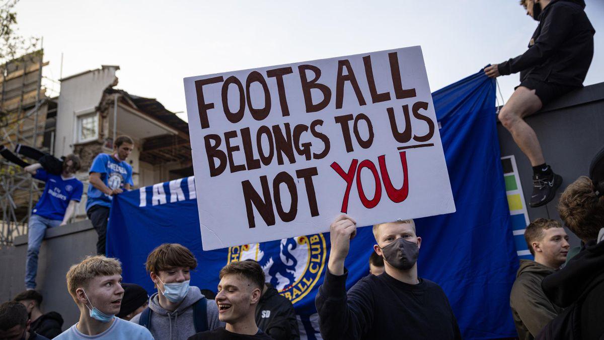 Chelsea Football Club fans celebrate outside the team's Stamford Bridge stadium