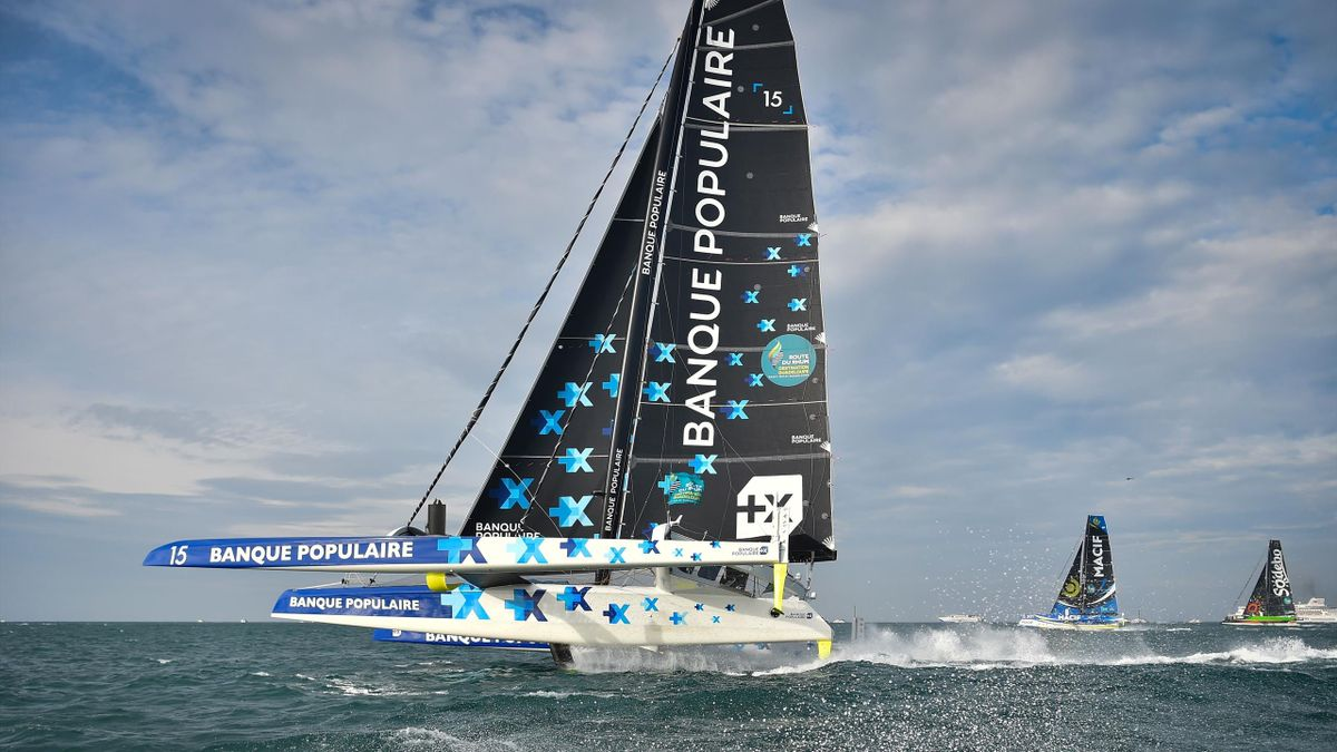 French skipper Armel Le Cleac'h (L) onboard his Ultim multihull Maxi Solo Banque Populaire IX