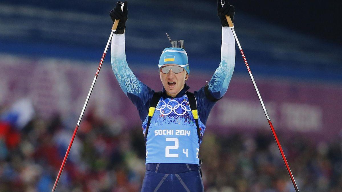 Ukraine's Olena Pidhrushna celebrates winning biathlon relay gold