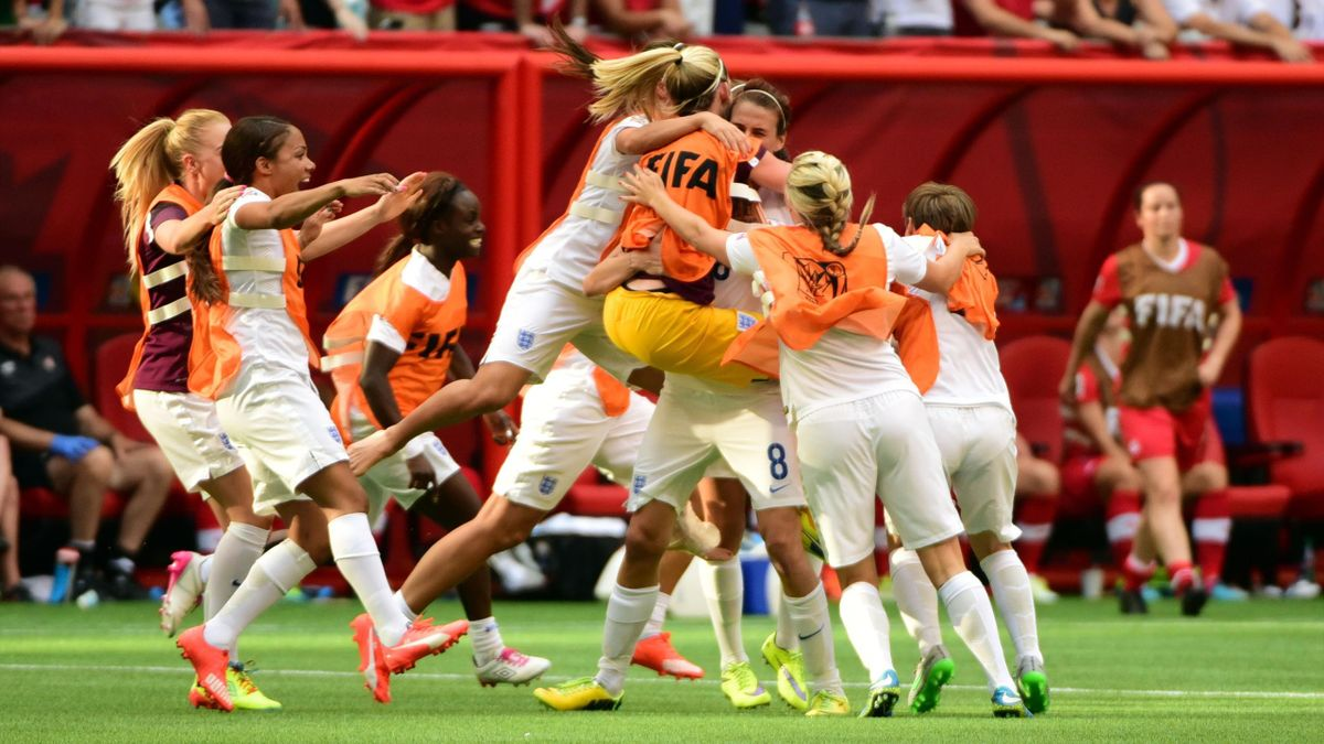 ; England midfielder Jill Scott (8) celebrates with teammates after defeating Canada in the quarterfinals of the FIFA 2015 Women's World Cup at BC Place Stadium