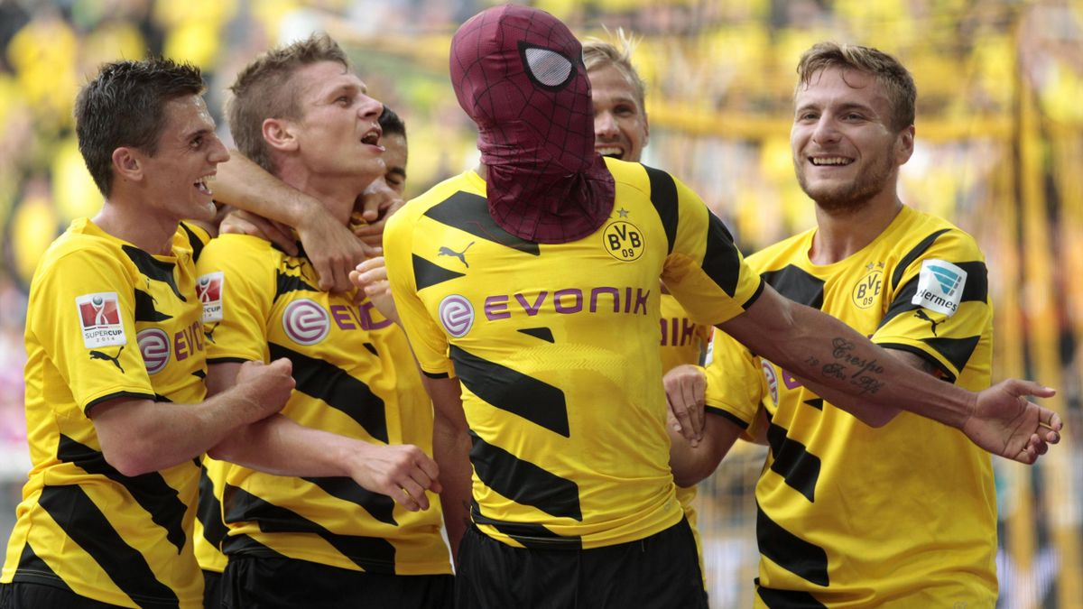 Borussia Dortmund's Pierre-Emerick Aubameyang (with Spiderman mask) and teammates celebrate a goal against Bayern Munich