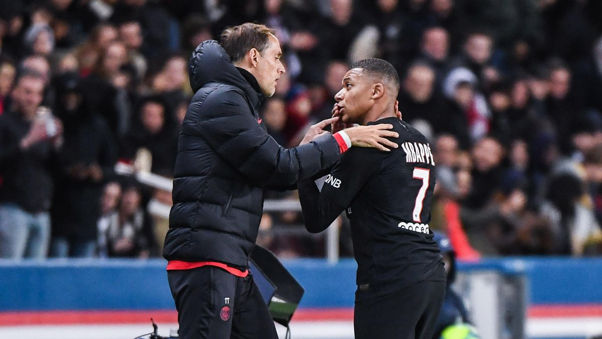 Kylian MBAPPE of PSG talks with Thomas TUCHEL coach of PSG during the Ligue 1 match between Paris and Montpellier at Parc des Princes on February 1, 2020 in Paris, France.