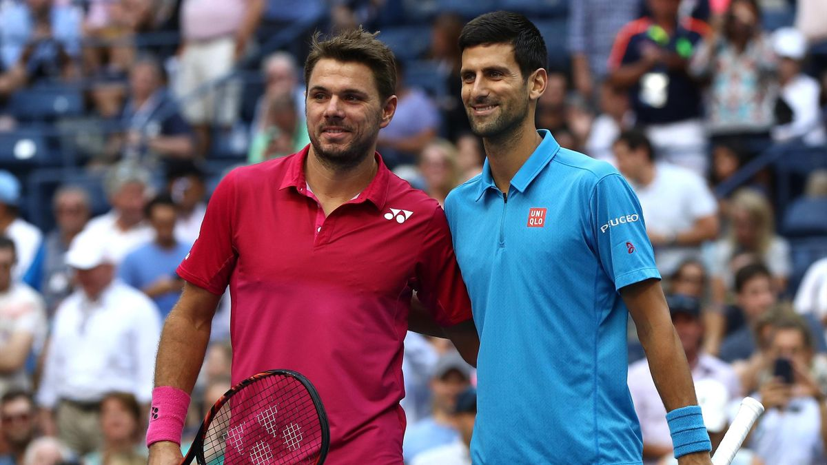 Stan Wawrinka (L) of Switzerland and Novak Djokovic of Serbia