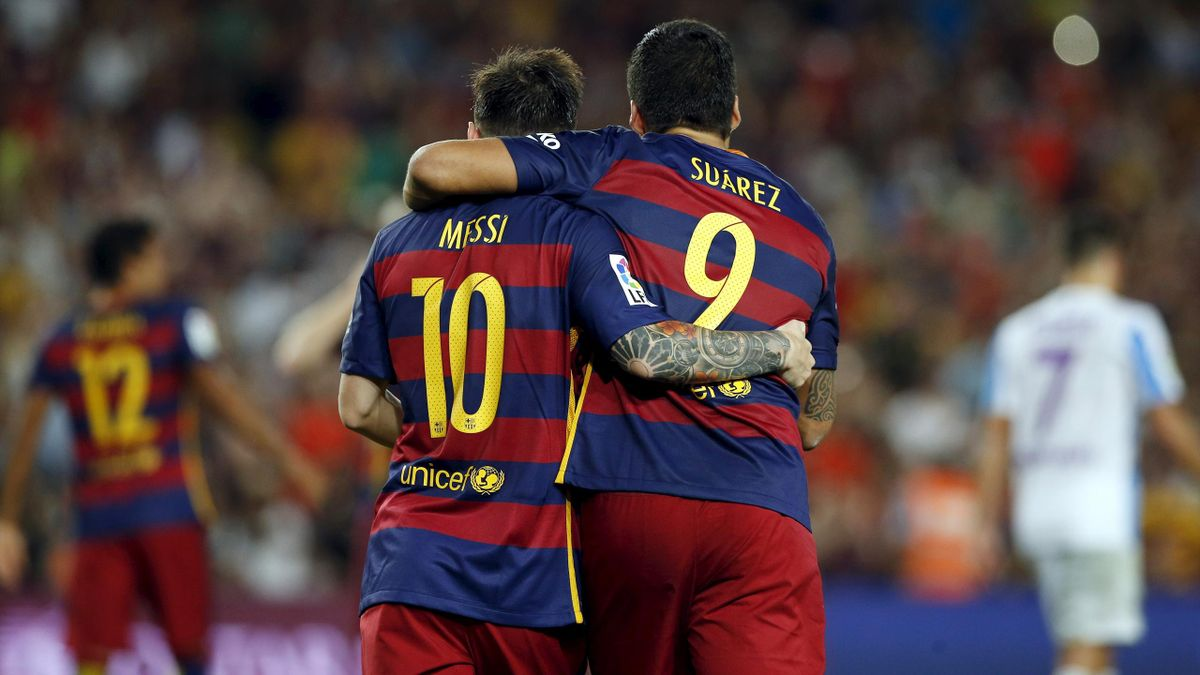 Barcelona's Lionel Messi (L) and Luis Suarez celebrate a goal against Malaga during their Spanish first division soccer match at Camp Nou stadium in Barcelona, Spain, August 29, 2015
