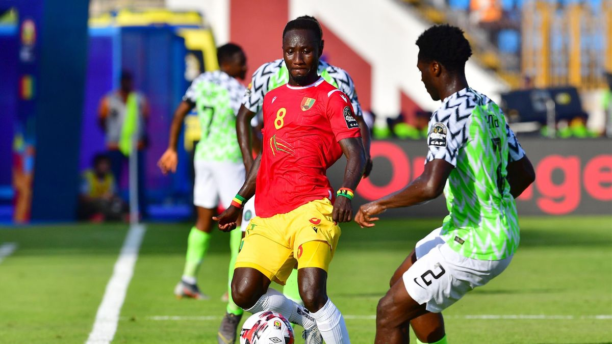 Guinea's midfielder Naby Keita (L) is marked by Nigeria's defender Olaoluwa Aina during the 2019 Africa Cup of Nations (CAN) football match between Nigeria and Guinea at the Alexandria Stadium on June 26 , 2019