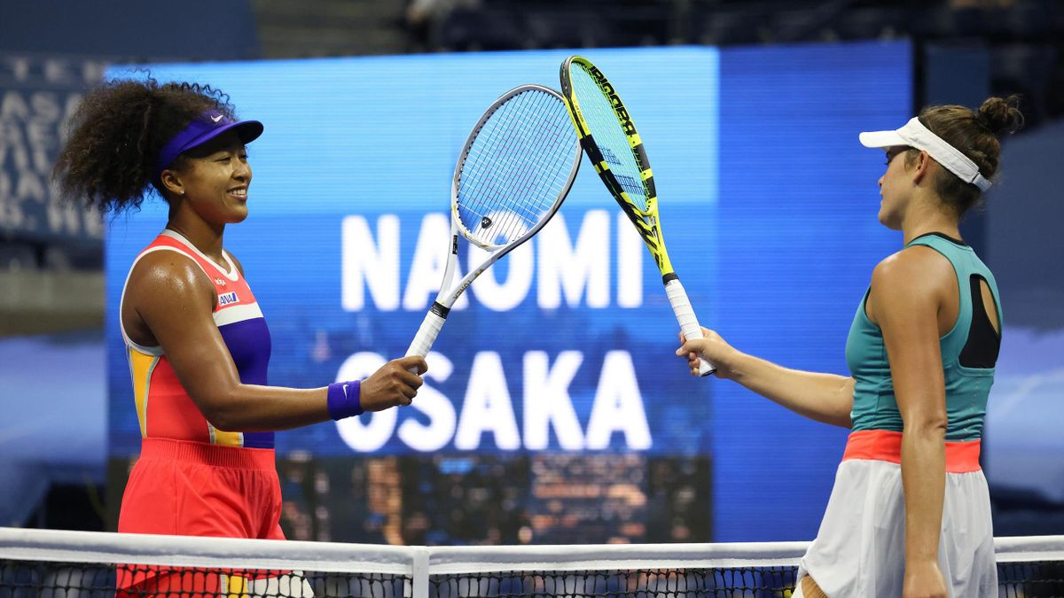 Naomi Osaka of Japan taps rackets at center court with Jennifer Brady of the United States after winning their Women's Singles semifinal match on Day Eleven of the 2020 US Open at the USTA Billie Jean King National Tennis Center