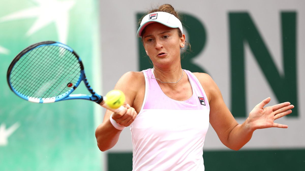 Irina-Camelia Begu of Romania plays a forehand during the ladies singles first round match against Anna Karolina Schmiedlova of Slovakia during day three of the 2018 French Open at Roland Garros