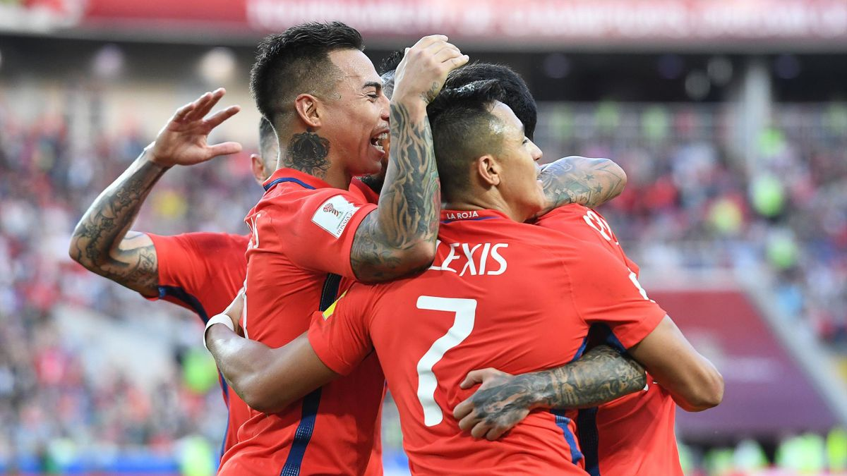 Chile's forward Martin Rodriguez (R hidden) celebrates after scoring a goal with team mates