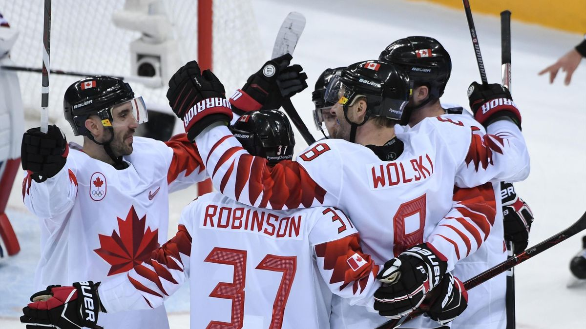 anada's Wojciech Wolski (2nd R) celebrates scoring in the men's bronze medal ice hockey match between the Czech Republic and Canada during the Pyeongchang 2018 Winter Olympic Games at the Gangneung Hockey Centre in Gangneung on February 24, 2018