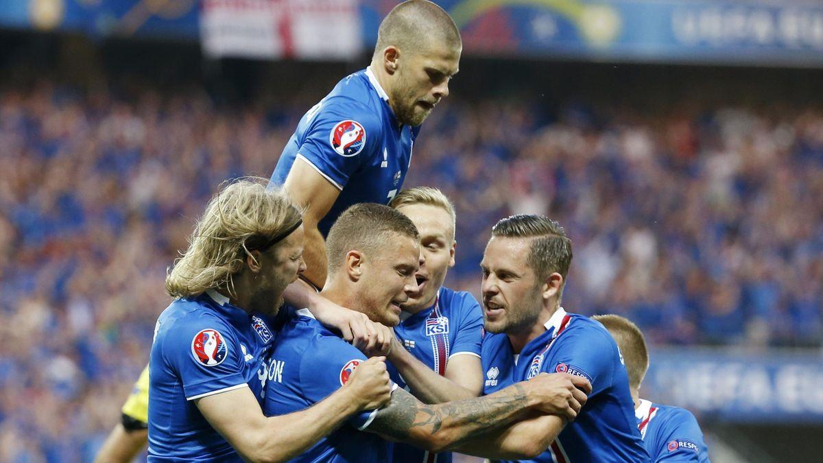 Iceland's Ragnar Sigurdsson celebrates scoring their first goal