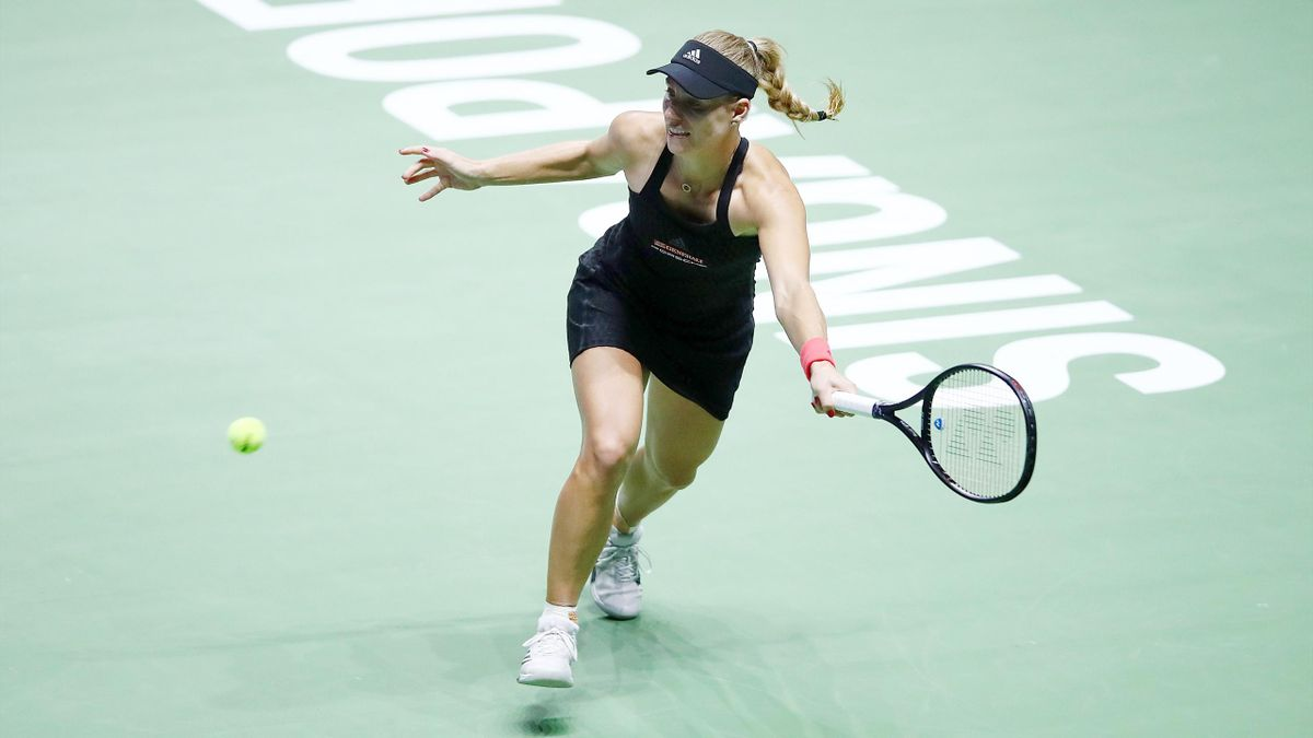 Angelique Kerber of Germany plays a forehand in her women's singles match against Naomi Osaka of Japan during day 4 of the BNP Paribas WTA Finals Singapore presented by SC Global at Singapore Sports Hub on October 24, 2018 in Singapore. at Singapore Spor