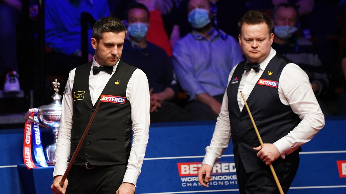 England's Mark Selby and Shaun Murphy look on during day 16 of the Betfred World Snooker Championships 2021 at Crucible Theatre on May 2, 2021 in Sheffield, England.