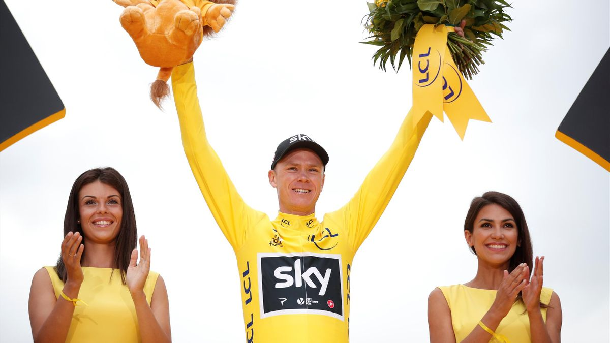 Team Sky rider and yellow jersey Chris Froome of Britain celebrates his overall win on the podium