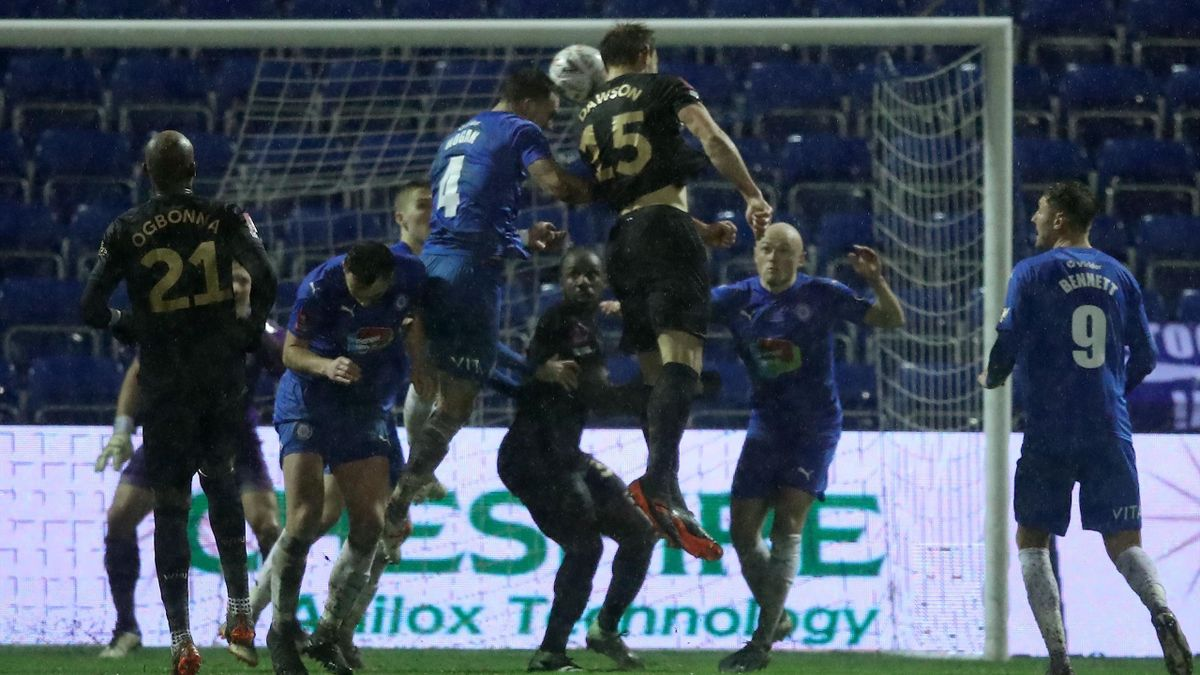 West Ham United's English defender Craig Dawson (3R) headers the ball to score the opening goal during the English FA Cup third round football match between Stockport County and West Ham United at the Edgeley Park ground in Stockport, north west England,