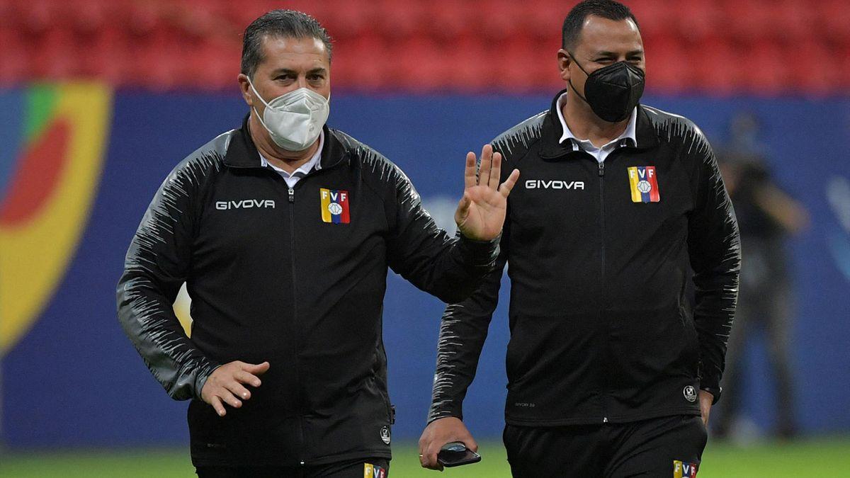 Venezuela's Portuguese coach Jose Peseiro (L) at the Mane Garrincha Stadium