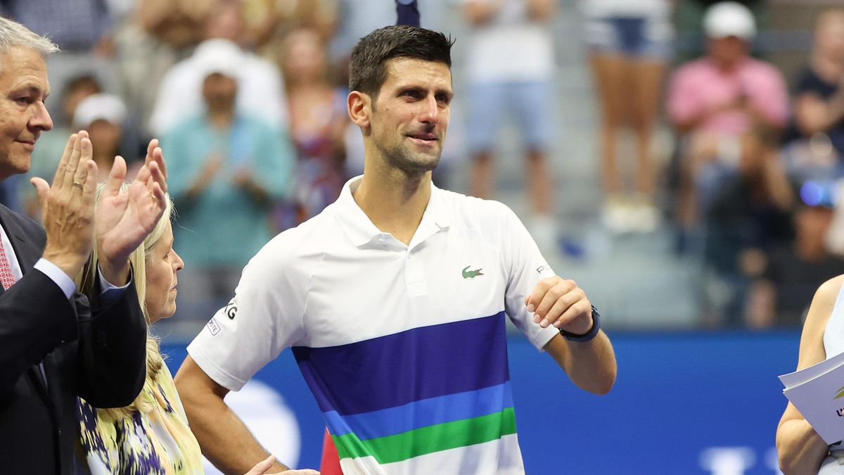 Runner up Novak Djokovic of Serbia reacts during the trophy ceremony after being defeated by Daniil Medvedev of Russia during their Men's Singles final match on Day Fourteen of the 2021 US Open at the USTA Billie Jean King National Tennis Center