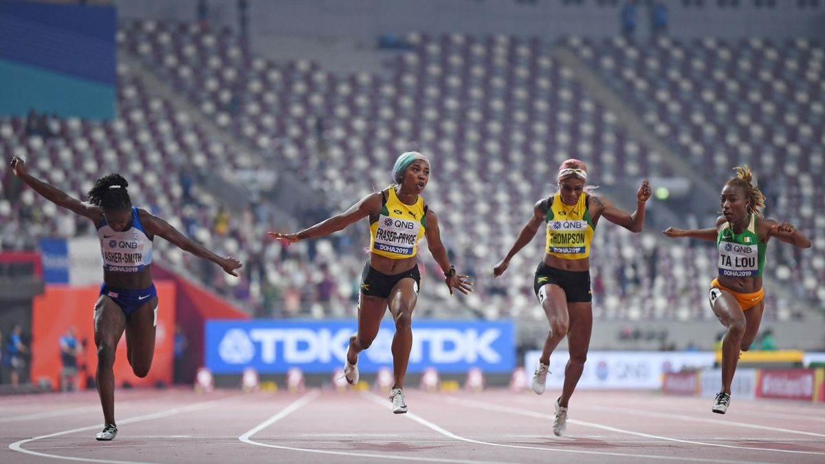 Jamaica's Shelly-Ann Fraser-Pryce finishes ahead of Britain's Dina Asher-Smith in the Women's 100m final at the 2019 IAAF World Athletics Championships at the Khalifa International Stadium in Doha on September 29