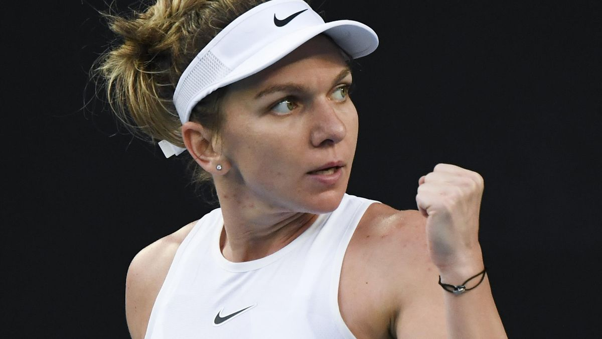 Romania's Simona Halep reacts after winning the first set against Jennifer Brady of the US during their women's singles match on day two of the Australian Open tennis tournament in Melbourne on January 21, 2020