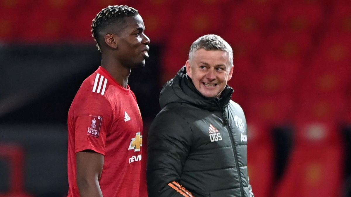 Manchester United's Paul Pogba and Ole Gunnar Solskjaer