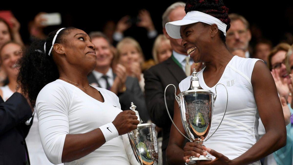 USA's Serena Williams and Venus Williams celebrate winning