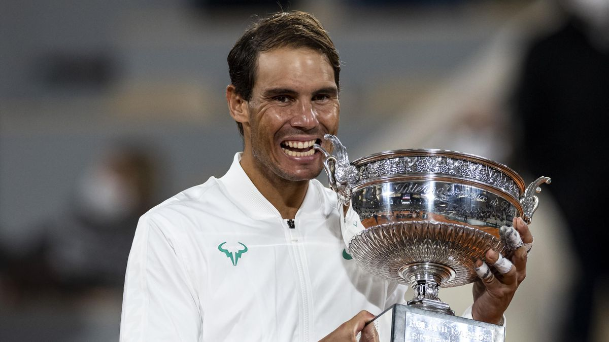 Rafael Nadal of Spain celebrates with the trophy after his victory over Novak Djokovic of Serbia in the final of the men's singles at Roland Garros