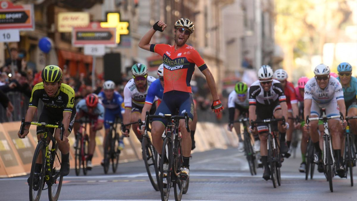 taly's Vincenzo Nibali (C) of team Bahrain celebrates as he crosses the finish line to win the 109th edition of the Milan - San Remo cycling race on March 17, 2018. The 2014 Tour de France winner, nicknamed 'The Shark', cut through the sprint favourites a